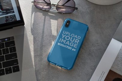 Mockup of a Clear Phone Case Placed Next to a Pair of Sunglasses 4639-el1