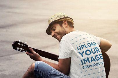 Back-View T-Shirt Mockup of a Man Playing Guitar 37150-r-el2