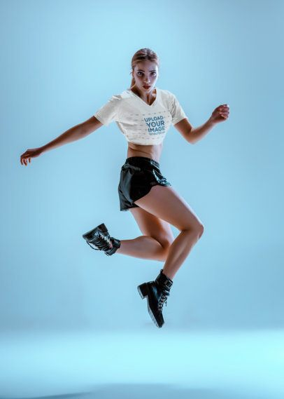 Crop Top Mockup of a Woman Jumping in a Studio 37558-r-el2