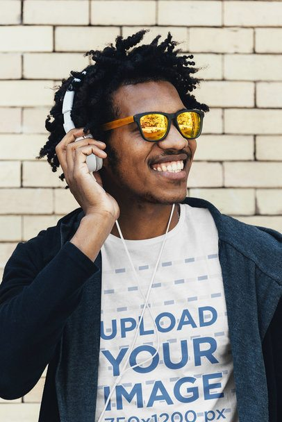 T-Shirt Mockup of a Smiling Man Listening to Music 37778-r-el2