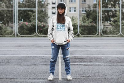 Mockup of a Woman with an Oversize Hoodie Standing on a Parking Lot 37608-r-el2