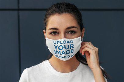 Face Mask Mockup of a Woman Posing Against a Dark Wall 4673-el1
