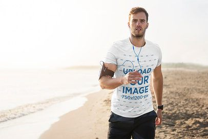 T-Shirt Mockup of a Man Jogging at the Beach 38234-r-el2