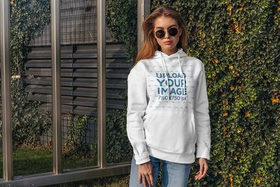 Hoodie Mockup of a Woman Standing by an Ivy-Covered Wall 4778-el1