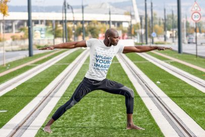 T-Shirt Mockup of a Man Doing Yoga on a Tramway Track 37948-r-el2