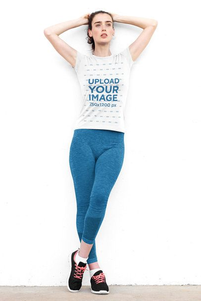 T-Shirt Mockup of a Woman in a Sporty Look Leaning on a White Wall 38240-r-el2
