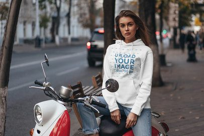 Hoodie Mockup of a Woman Sitting on a Vespa-Style Bike 4784-el1