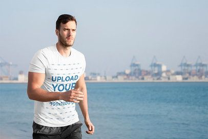 Activewear T-Shirt Mockup of a Fitness Man Running on a Bay 38235-r-el2