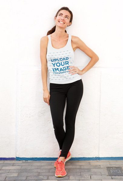 Tank Top Mockup of a Happy Woman Leaning Against a White Wall 37937-r-el2