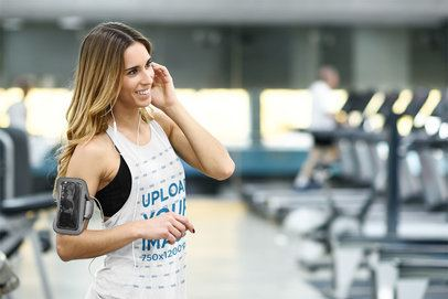 Tank Top Mockup Featuring a Woman Listening to Music at a Gym 38198-r-el2