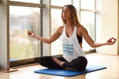 Mockup of a Woman with a Loose Tank Top Meditating at a Yoga Studio 37364-r-el2