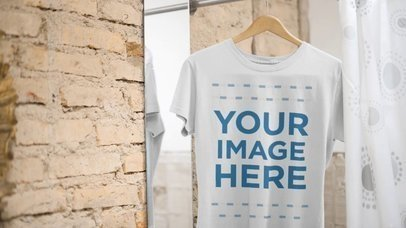 T-Shirt Mockup Video of a Round Neck Tee Hanging in a Changing Room a13140-122316