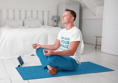 T-Shirt Mockup of a Middle-Aged Man Meditating at Home 37059-r-el2