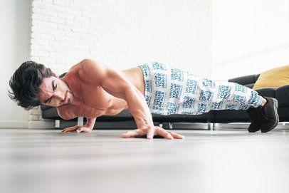 Sweatpants Mockup of a Man Doing Side Push-Ups at Home 37051-r-el2