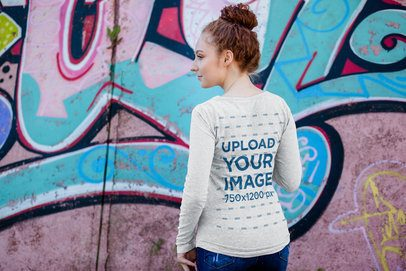 Back-View Long Sleeve Tee Mockup Featuring a Woman and Some Graffiti 4734-el1