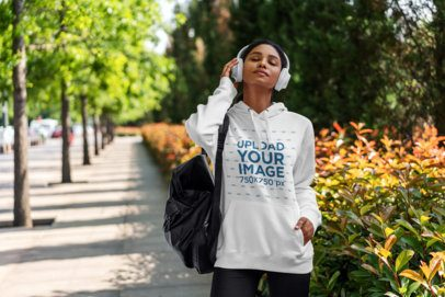 Pullover Hoodie Mockup of a Woman Listening to Music 4846-el1