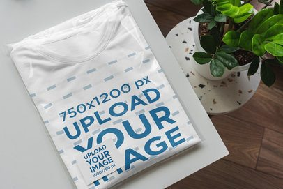 Mockup of a Folded T-Shirt Wrapped in a Transparent Bag with a Business Card Inside 4840-el1