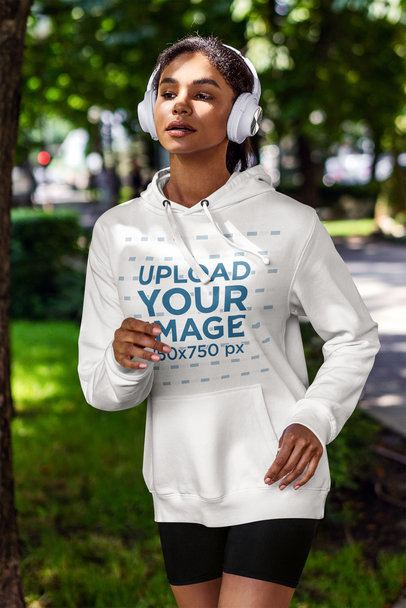 Mockup of a Woman with a Hoodie and Headphones Running on the Street 4849-el1