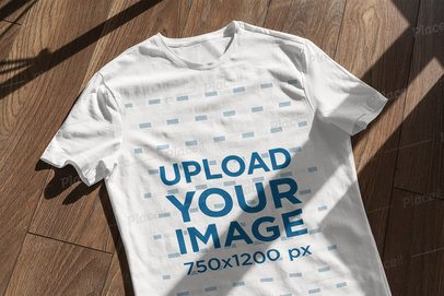 T-Shirt Mockup Featuring a Wooden Surface and a Window Shadow 4843-el1