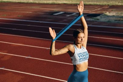 Sports Bra Mockup of a Tattooed Woman at a Running Track 38595-r-el2