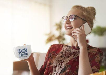 Mockup of a Woman with a 24 oz Coffee Mug Talking on the Phone 38110-r-el2