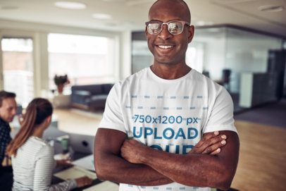 Mockup of a Smiling Man Wearing a Tee Inside an Office 38960-r-el2