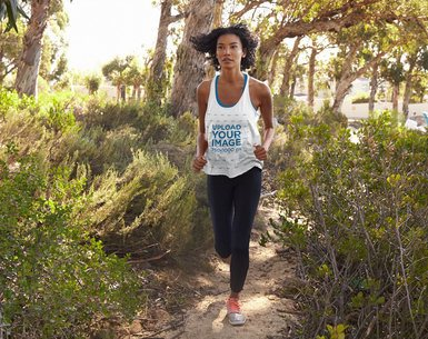 Mockup of a Woman with a Loose Tank Top Running in the Woods 39015-r-el2