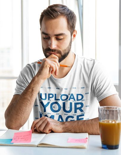 T-Shirt Mockup of a Man Taking Notes While Working From Home 38155-r-el2