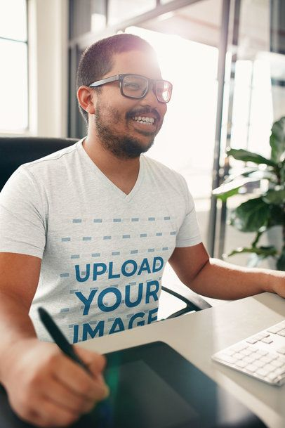 Mockup of a Smiling Man with a V-Neck Tee Working at an Office 34869-r-el2