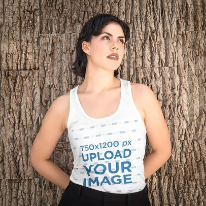 Tank Top Mockup of a Woman Leaning Against a Wall With a Tree Bark Texture 4716-el1