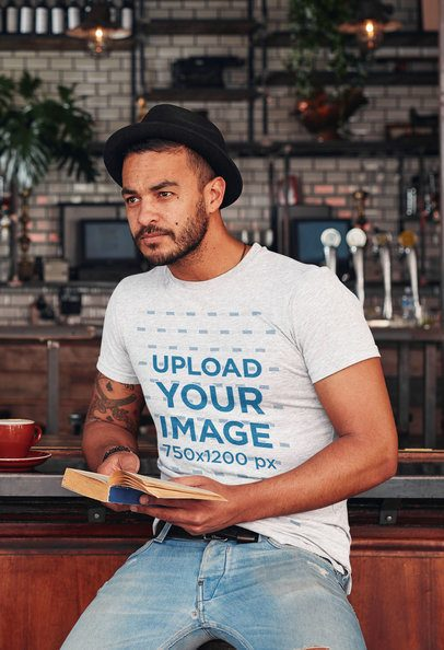 Heather T-Shirt Mockup of a Man Reading at a Pub 34986-r-el2