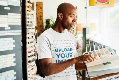 T-Shirt Mockup of a Man Looking at Fabric Samples 38684-r-el2
