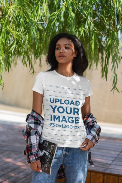 T-Shirt Mockup Featuring a Young Serious Woman Posing Under a Tree 4817-el1