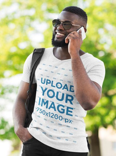 Mockup of a Stylish Bearded Man Wearing a Heather V-Neck Tee on the Street 38907-r-el2