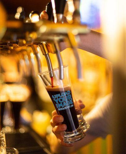 Mockup of Someone Serving Dark Beer in a Glass 36051-r-el2
