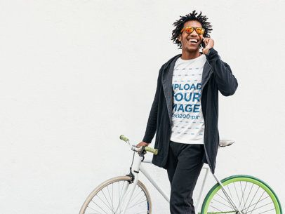 T-Shirt Mockup of a Man Talking on the Phone while Holding His Bike 37783-r-el2