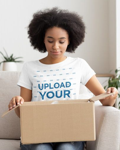 T-Shirt Mockup of a Woman Opening a Package 38996-r-el2