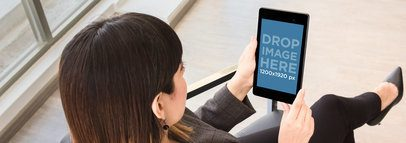 Business Woman Holding A Nexus 7 Overshoulder Shot Wide