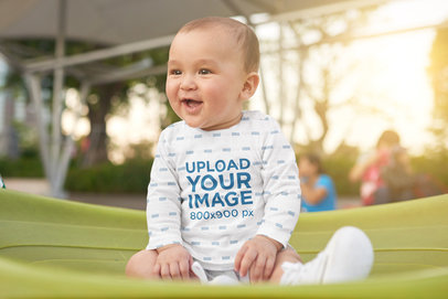 Mockup of a Baby Having Fun at a Park While Wearing a Sublimated Long Sleeve Tee 37339-r-el2