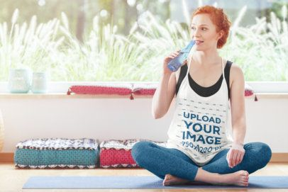 Mockup of a Woman with a Loose Tank Top Drinking Water at a Yoga Class 38478-r-el2
