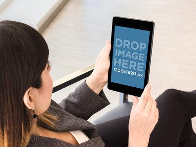 Business Woman Holding A Nexus 7 Over Shoulder Shot