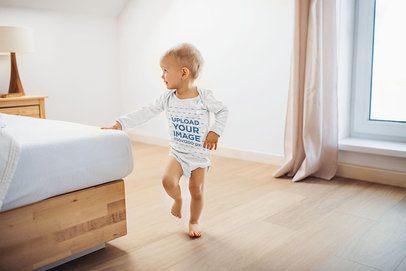 Onesie Mockup of a Baby Girl Playing in Her Parents' Bedroom 35221-r-el2