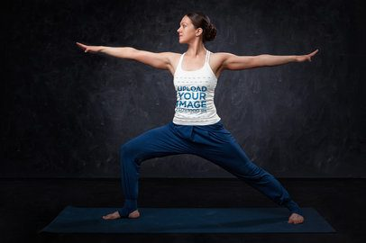 Tank Top Mockup of a Woman Practicing Yoga in Front of a Dark Wall 38741-r-el2