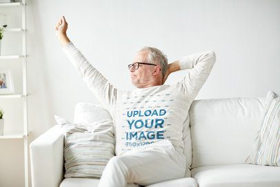 Mockup of a Senior Man with a Heather Sweatshirt Stretching in the Living Room 39132-r-el2