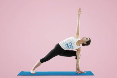 Mockup of a Woman Wearing a Tank Top While Doing Yoga in a Studio 38735-r-el2