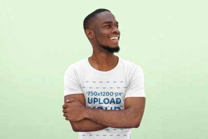 T-Shirt Mockup Featuring a Smiling Young Man in a Studio 38932-r-el2