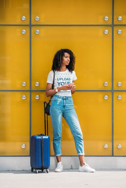 T-Shirt Mockup of a Woman with a Suitcase Waiting on the Street 34953-r-el2
