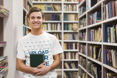 T-Shirt Mockup of a Young College Student at a Library 39187-r-el2