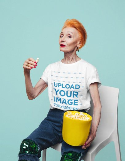 T-Shirt Mockup of a Cool Senior Woman Eating Popcorn at a Studio 39061-r-el2
