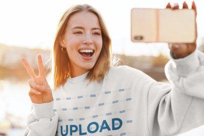 Selfie Mockup of a Happy Woman Wearing a Crewneck Sweatshirt Outside 39036-r-el2